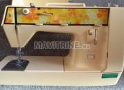 Photo de l'annonce: Machine à coudre électrique SINGER